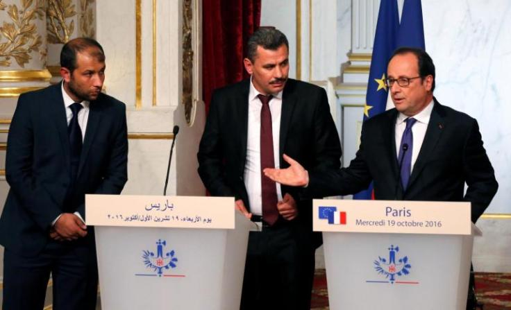President of the Syrian White Helmets Raed Saleh, Brita Hagi Hassan, president of the city council for opposition-held Aleppo, and French President Hollande hold a joint news statement after a meeting at the Elysee Palace in Paris